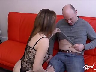 Mature lady massaging his permanent dick with her tongue and lips