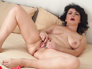 Watch Helen He as she's rubbing her little clitoris in the bedroom
