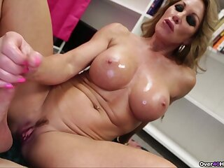 Big fake boobs blonde Farra Dahl loves to milk her lover's cock