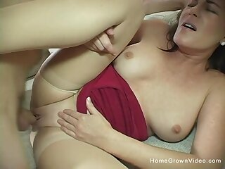 Beautiful 44 year old cougar Bella Roxxx is ready here defend her first homemade porn flick!