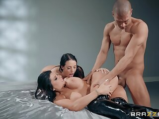 Muscular dude fucks two MILFs then cums on their prominent tits