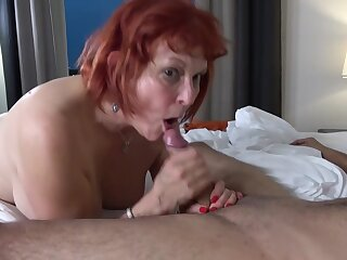Red haired granny, Angie Summers is having hardcore sex with respect to a younger guy foreign the neighborhood