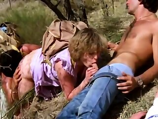 Slutty blonde in a hot outdoor threesome