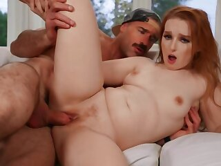 Mature guy copulates with enticing redhead in the living room